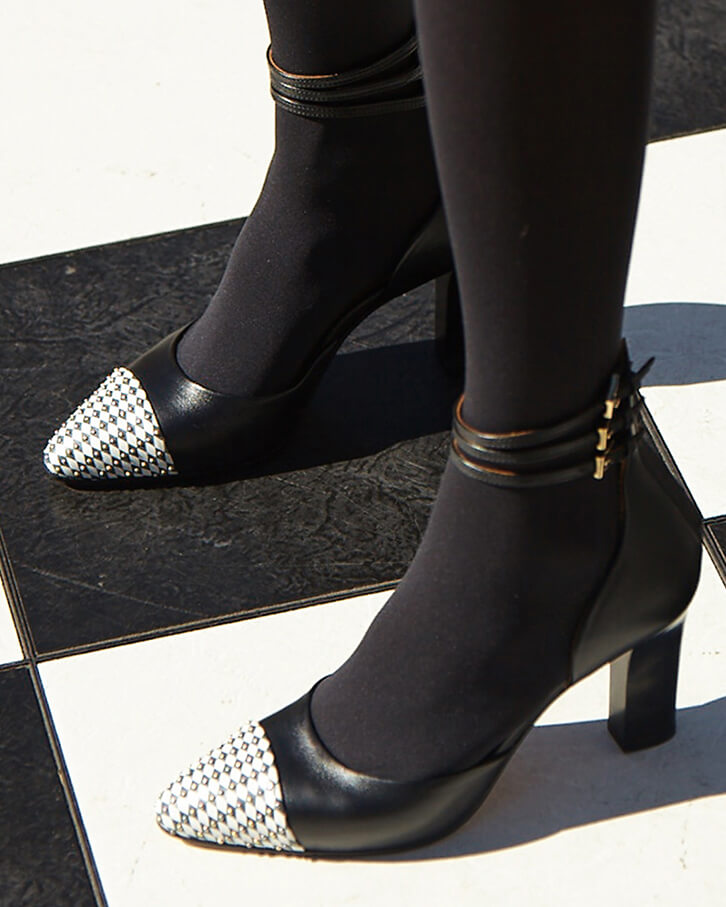 Diana black ankle strap high heels with black and white diamond pattern, studs, platform, anti-slip sole, memory foam padding and cuoio leather heels. Styled with rust black tights.