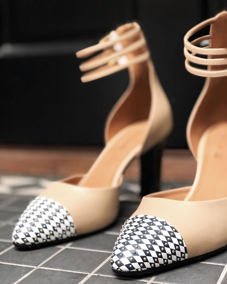 Diana beige ankle strap high heels with black and white diamond pattern, studs, platform, anti-slip sole, memory foam padding and cuoio leather heels.